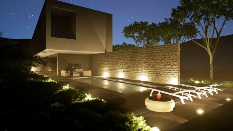 Render foto realistico che mostra una vista notturna della facciata  sulla piscina relativo al progetto di una casa di campagna