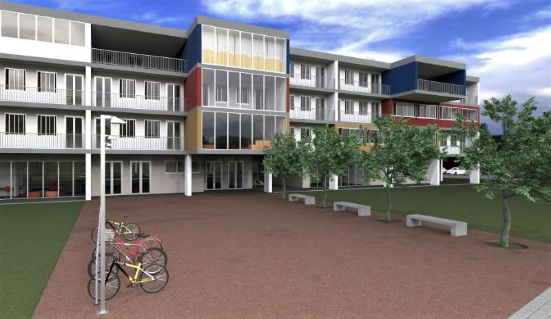 Render foto realistico che mostra una vista della facciata dal viale principale d'ingresso relativa al progetto di una casa per studenti
