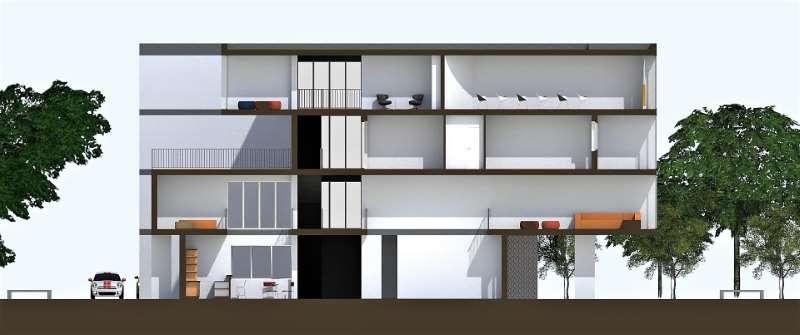 Immagine a colori che mostra la sezione trasversale sullo spazio centrale relativa al progetto di una casa per studenti